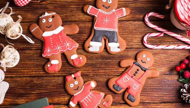 Christmas gingermen family on a wooden table