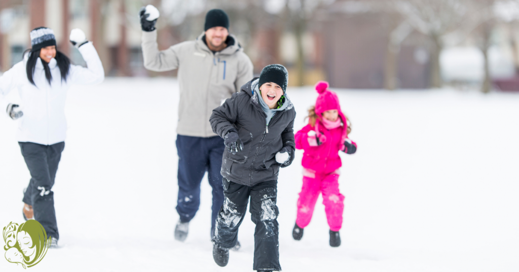 A family playing with snowballs as one of the ways to enjoy the snow with your kids.