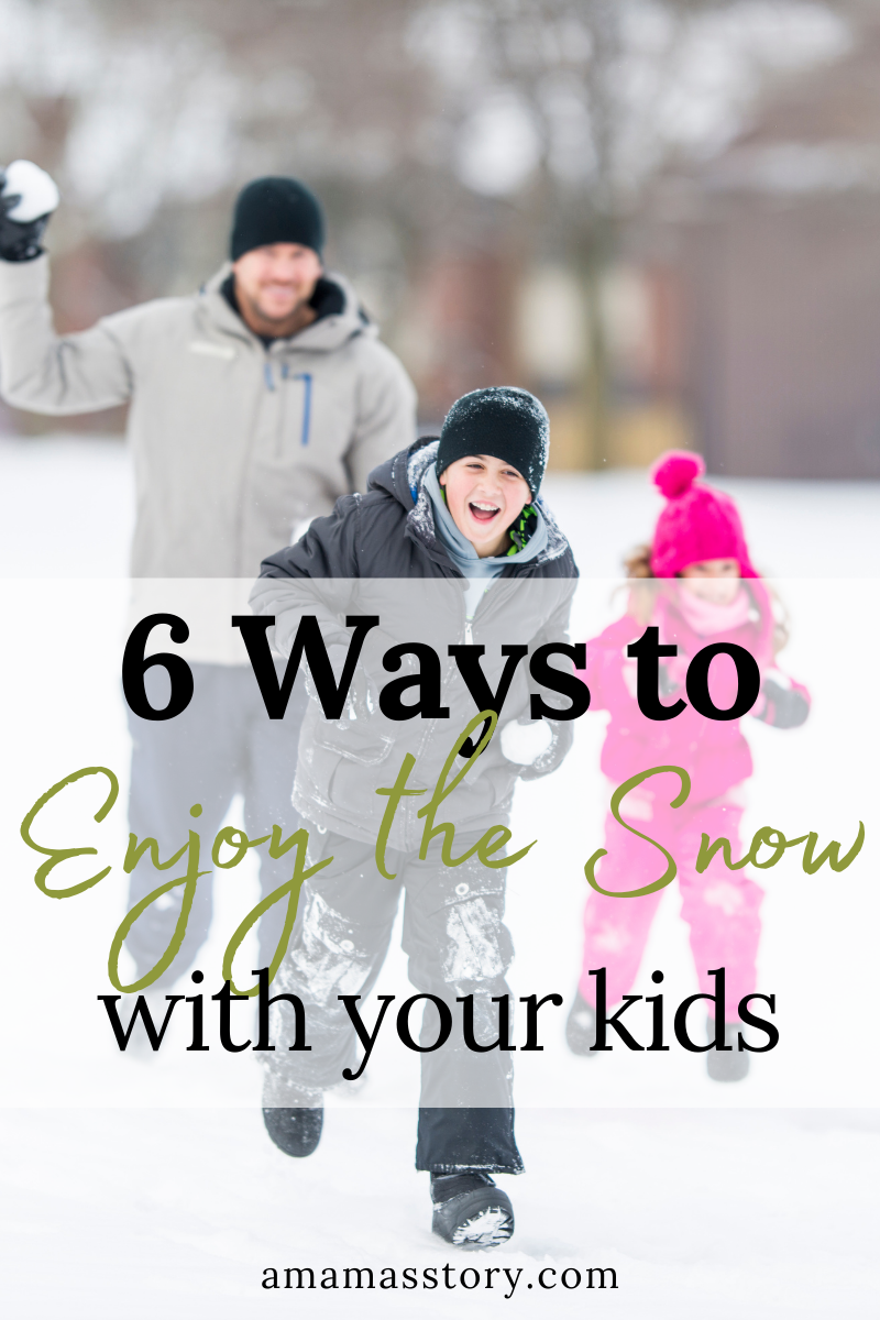 Family playing in the snow with ideas of ways to enjoy the snow with your kids.