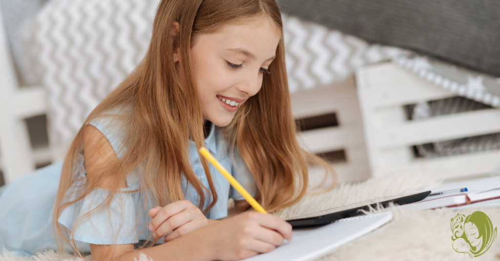 A girl writing in her literacy journal.