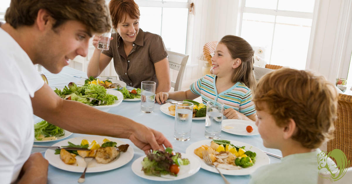A family eating together at the dinner table.