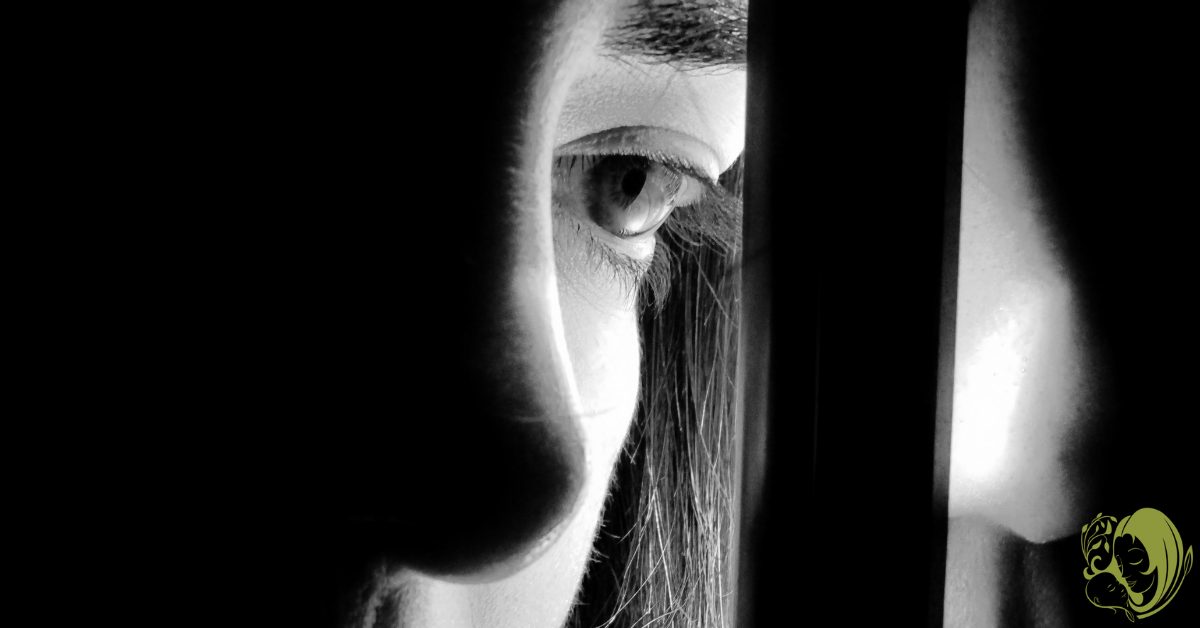 A depressed woman looking out the window.